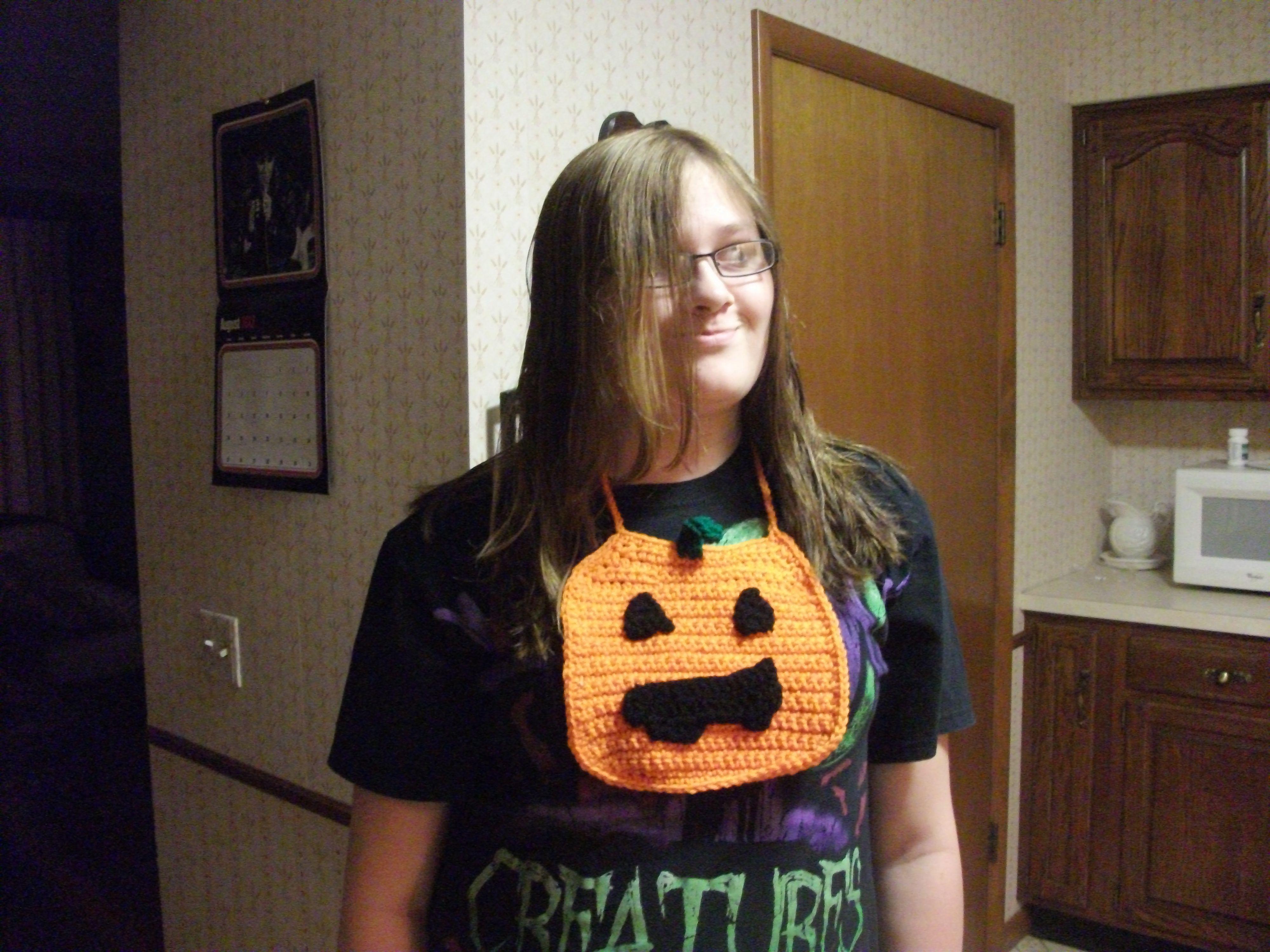 pumpkin bib for granddaughter modeled by her Aunt lol