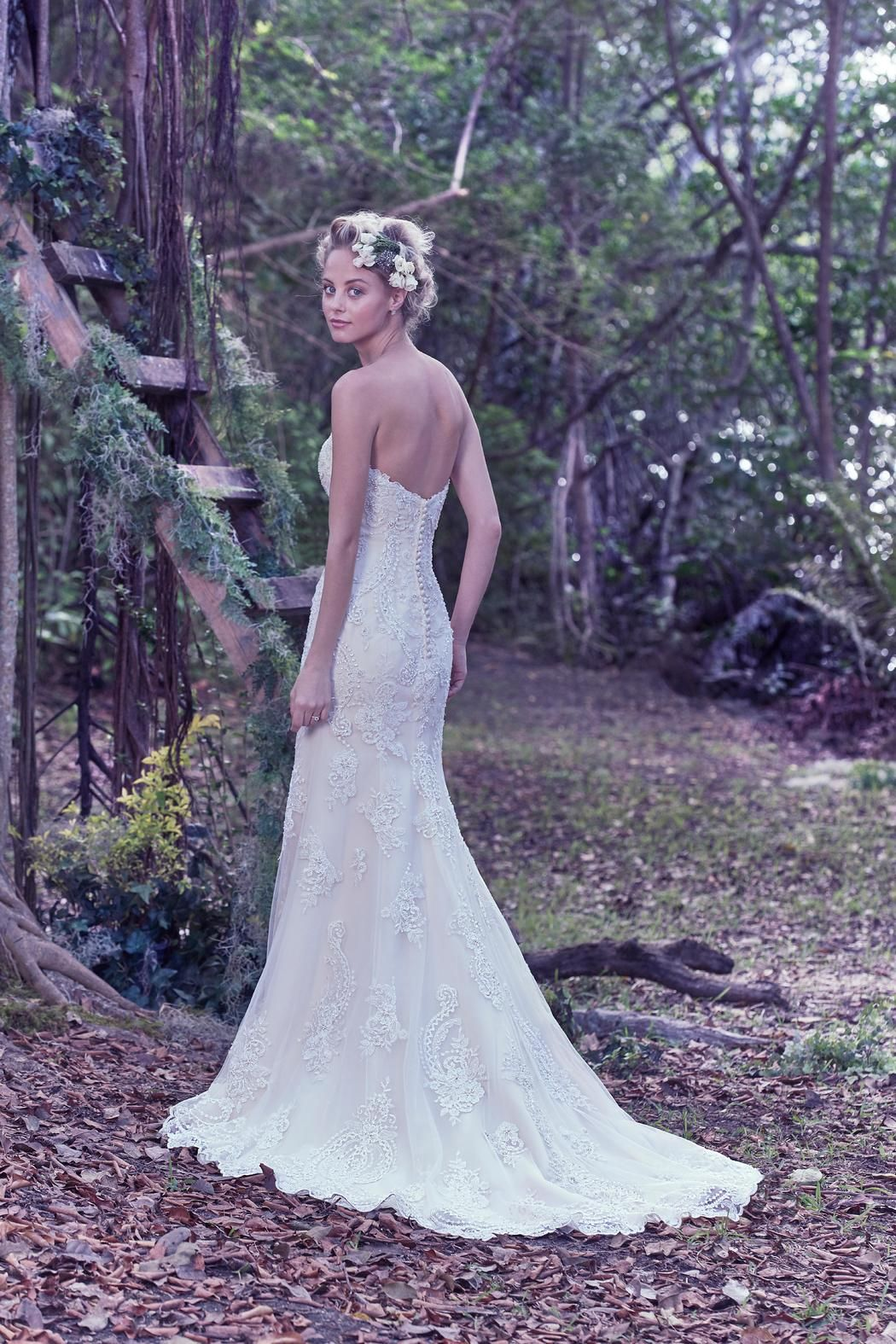 Romance is found in this classic tulle and lace sheath wedding dress