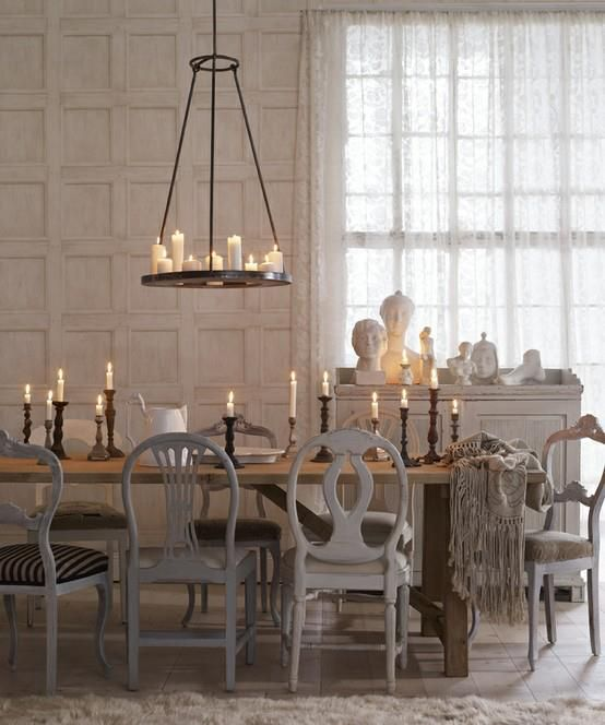 Love the variety of chairs and the candle chandelier!