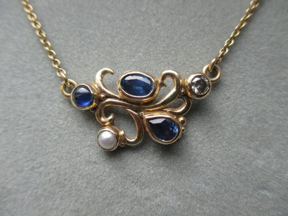 a449d804caacb 14Kt Solid Gold Asymmetric Swirl Sapphire, Diamond & Pearl Pendant ...
