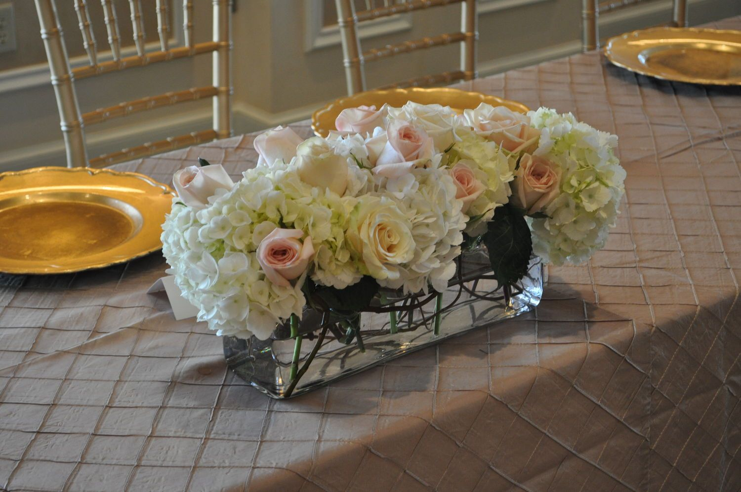 Floral arrangement head table hydrangea ivory and pale