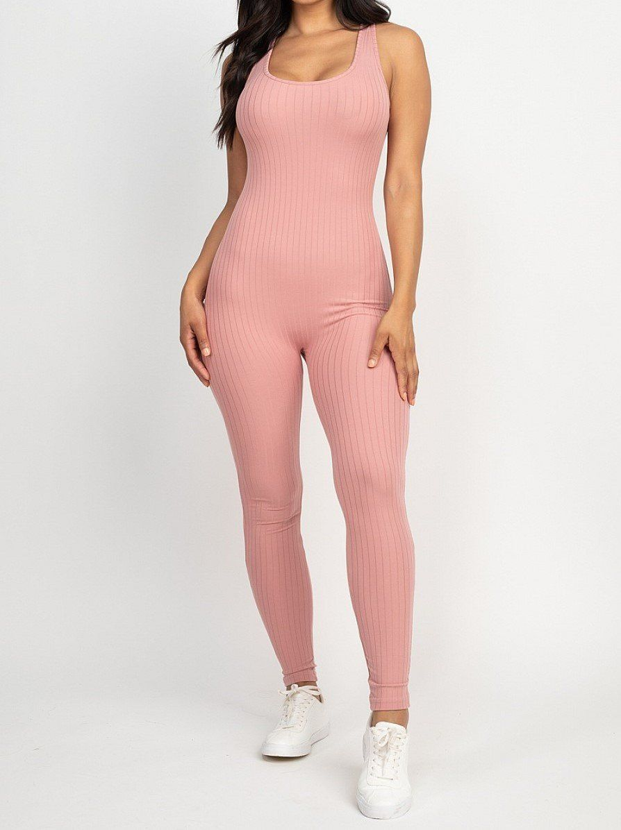 - Scoop neck bodycon jumpsuit - Sleeveless - Ribbed knit - Fitted - Solid - 92% Polyester 8% Spandex