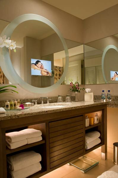 TV and round mirror for bathroom design