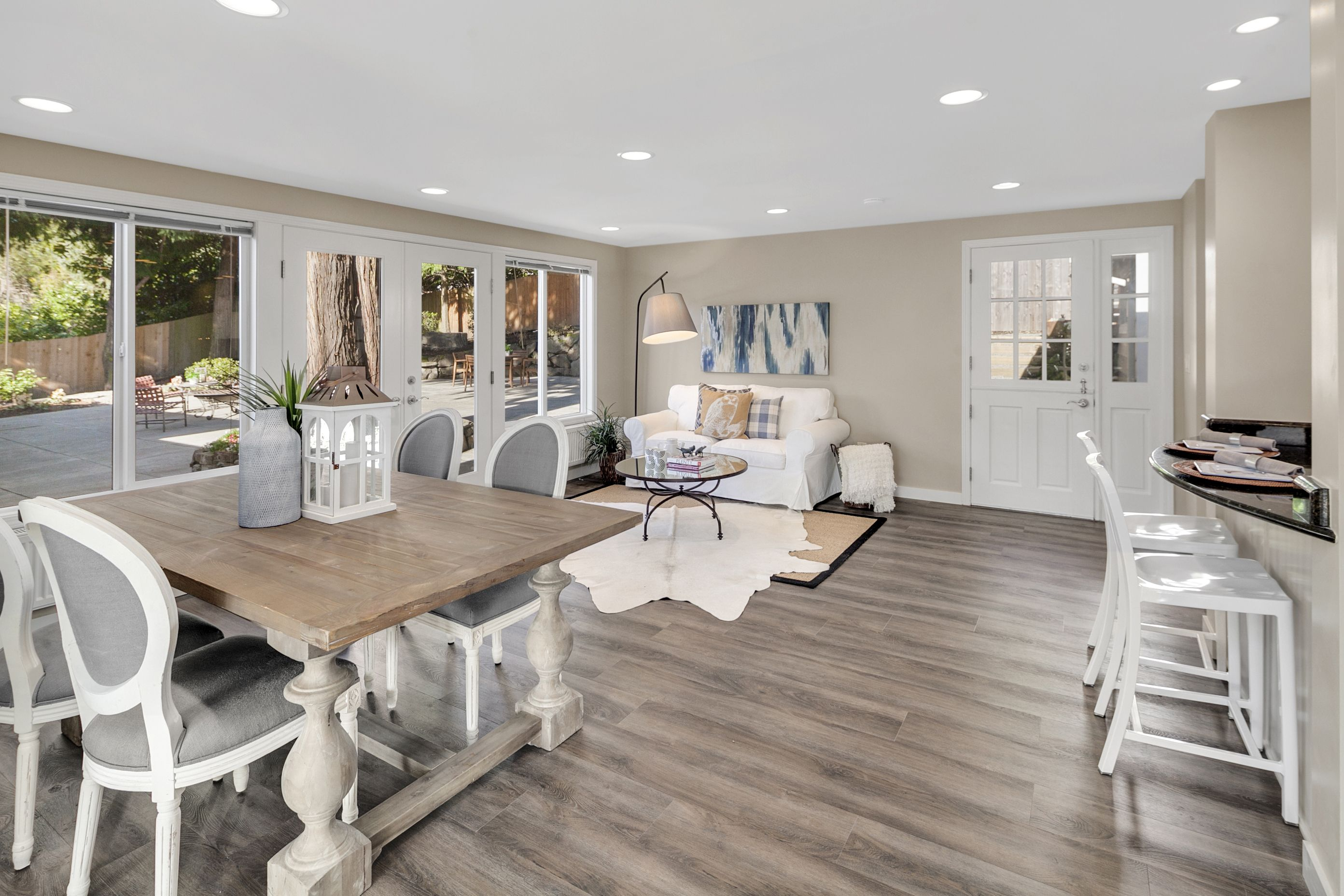 Wall color sw 9173 shiitake beautifully decorated open concept living space painted by amsberrys painting paint livingroom living sherwinwilliams