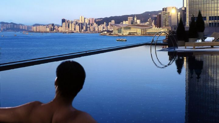 Four Seasons Hotel Hong Kong's heated infinity-edge pool (on the 6th floor) has some of the city's best views to the Victoria Harbour down below. Read more about the hotel at Best-Hong-Kong-Hotels.net.