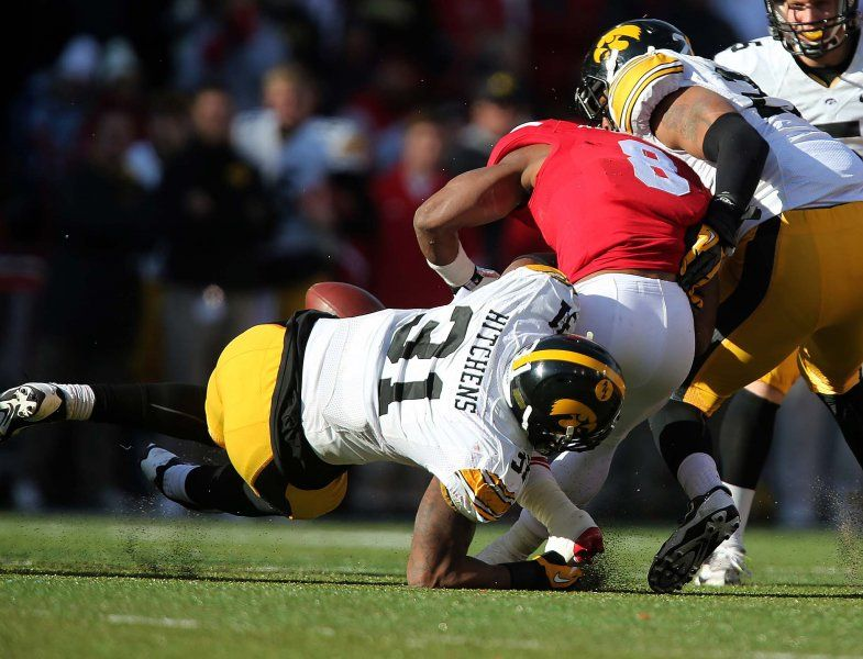 Iowa linebacker Anthony Hitchens forces a fumble after