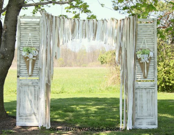 full length shutters with fabric garlands