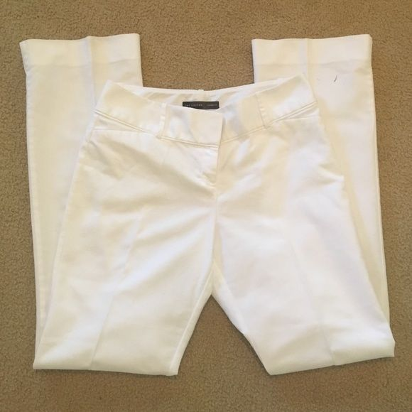 White Dress Pants Great condition, just don't fit me. There is a small black stain on the bottom back of the left pant leg (shown in pics). There is no size tag in them (was cut out for some reason), but they fit like a 6/8---waist measures 16 inches. 33 inch inseam. The Limited Pants Capris
