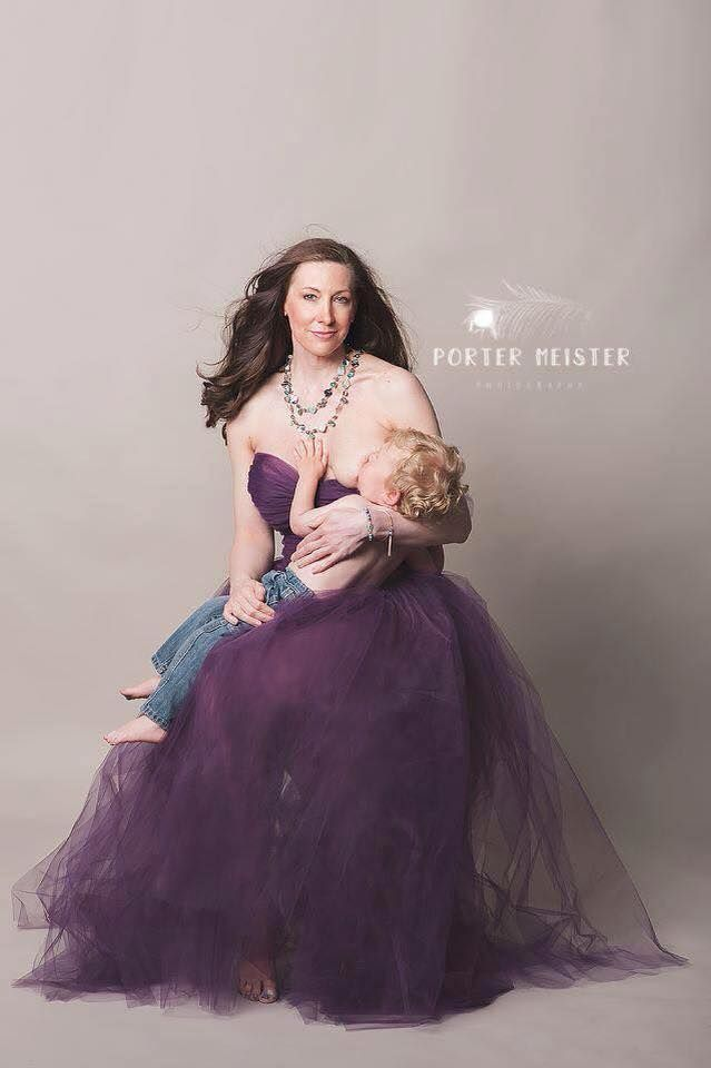 """Beautiful photo of a follower and her 2 year old son. """"This picture shows how I feel and shows how beautiful nurturing children is. Glam or no glam. It's the same feeling on the inside.""""  Plus what a great dress for an occasion."""