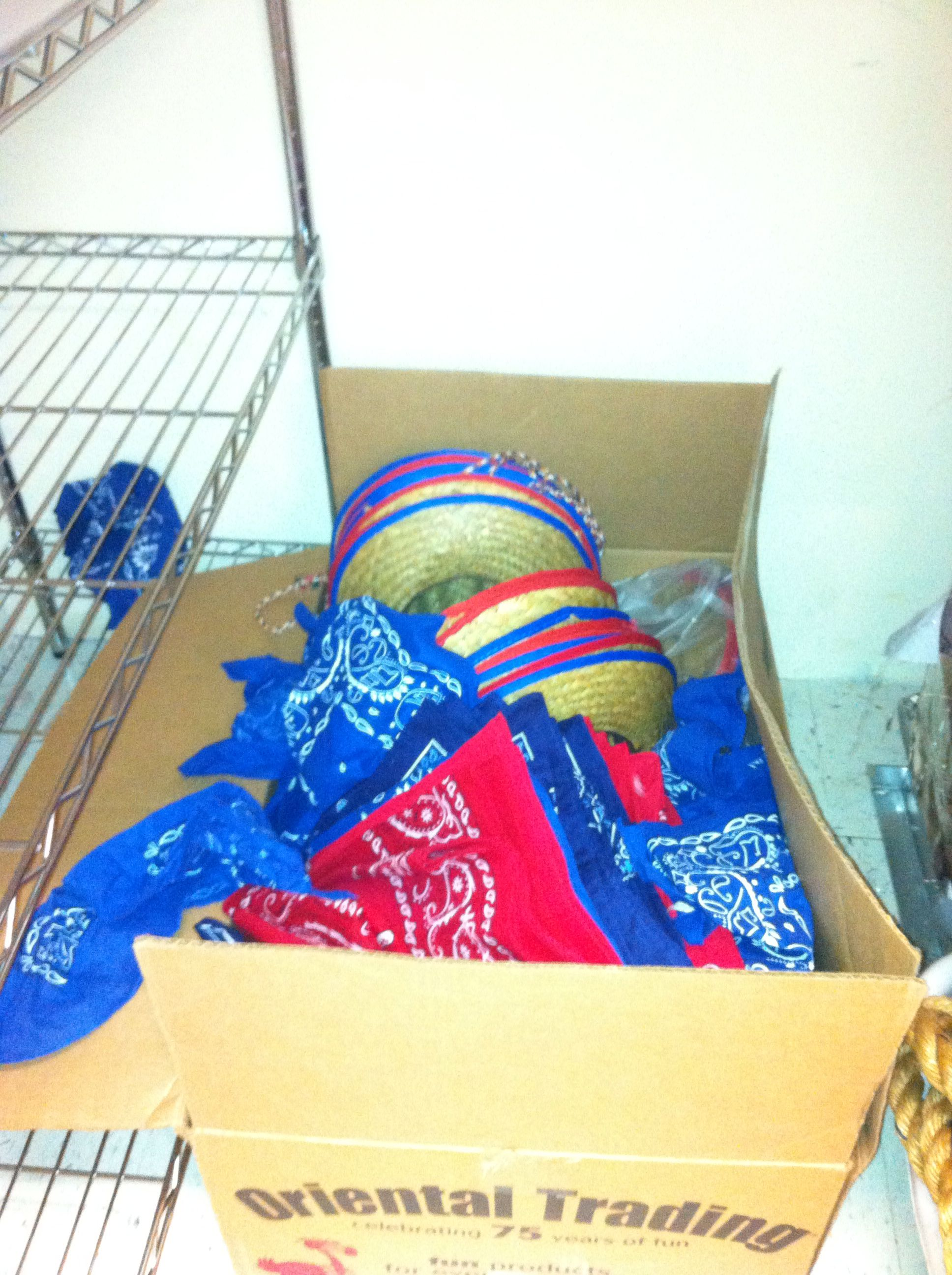 Dozens of hats and bandanas available in storage closet.