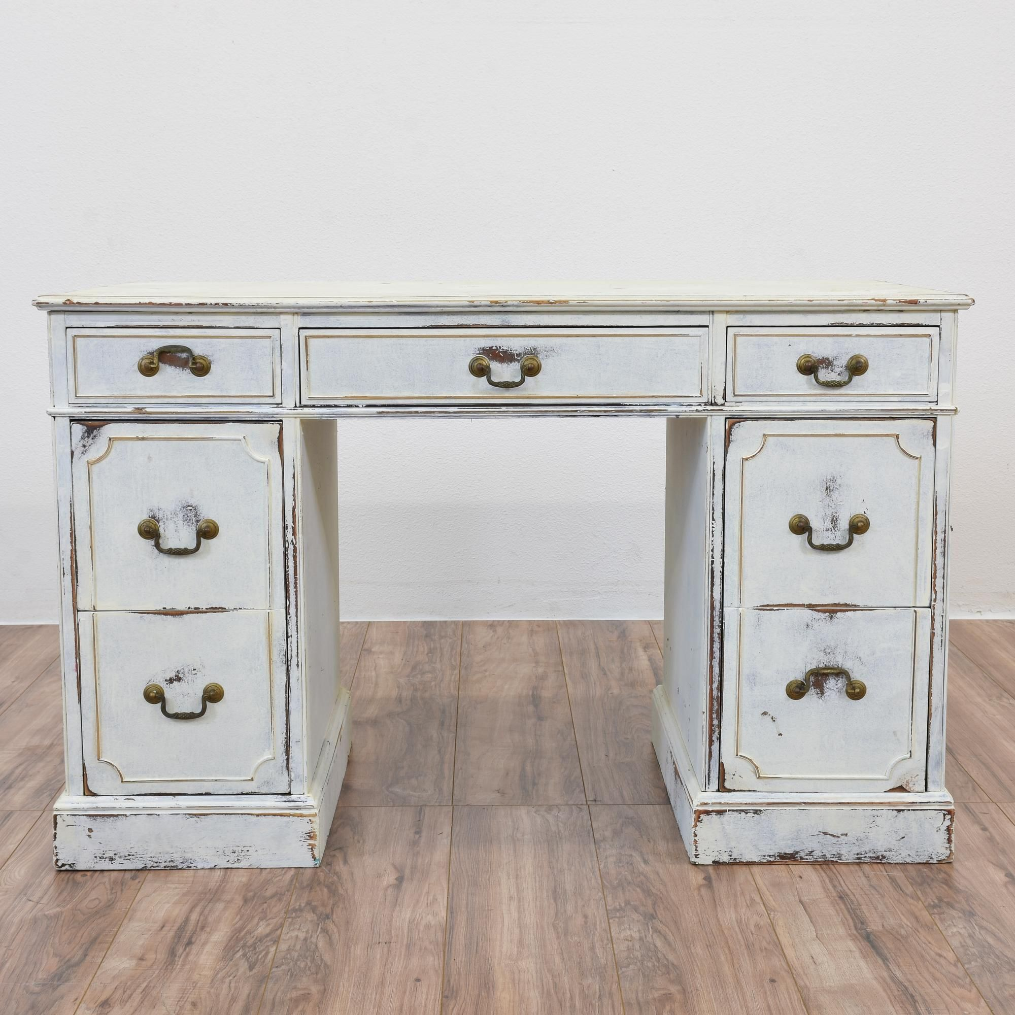 This shabby chic kneehole desk is featured in a solid wood painted