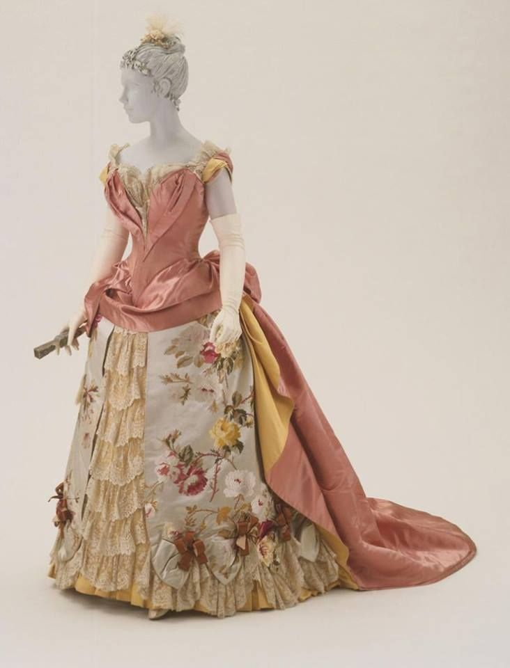 House of Worth, 1886-1887, silk satin, faille, and brocade with lace and rhinestones. Worn by Mrs. Ernest Fenollosa.