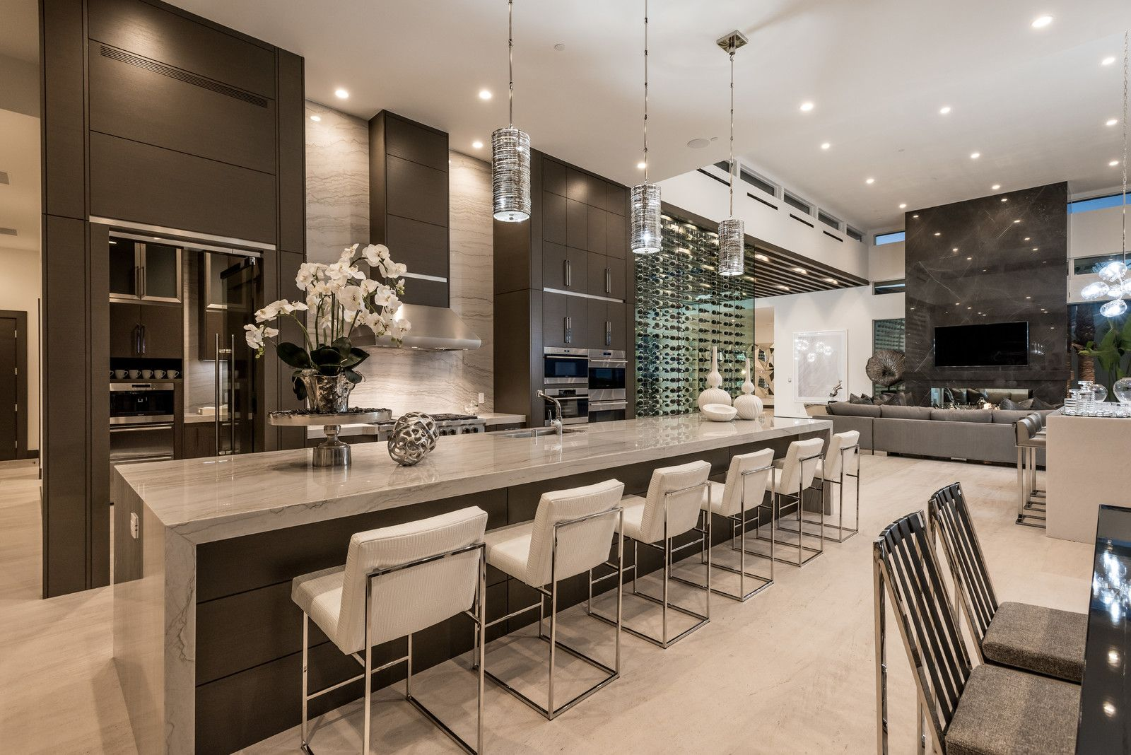 Open concept kitchen - large contemporary galley beige floor and