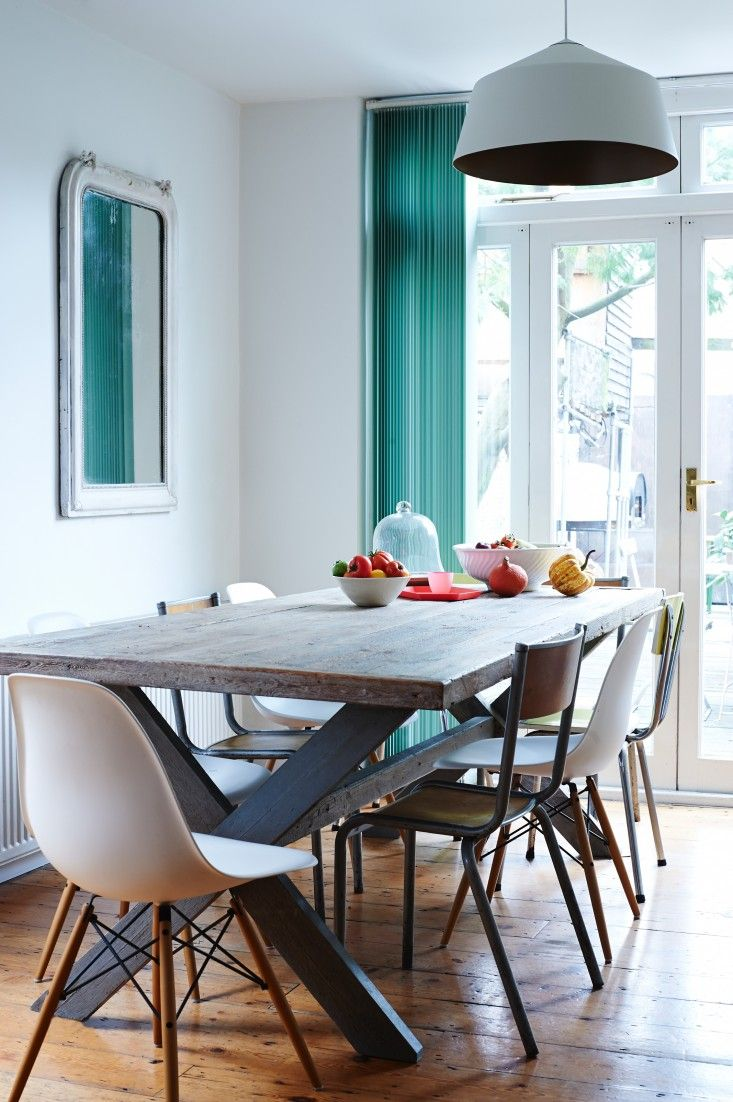 teal kitchen chairs Wood dining room table and teal curtain with white Eames molded plastic chairs in Anna Jones