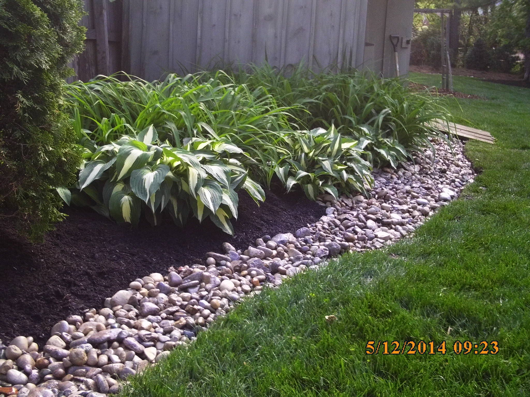 landscape job# 16 - mulch bed w/ river rock bank - spring cleanup