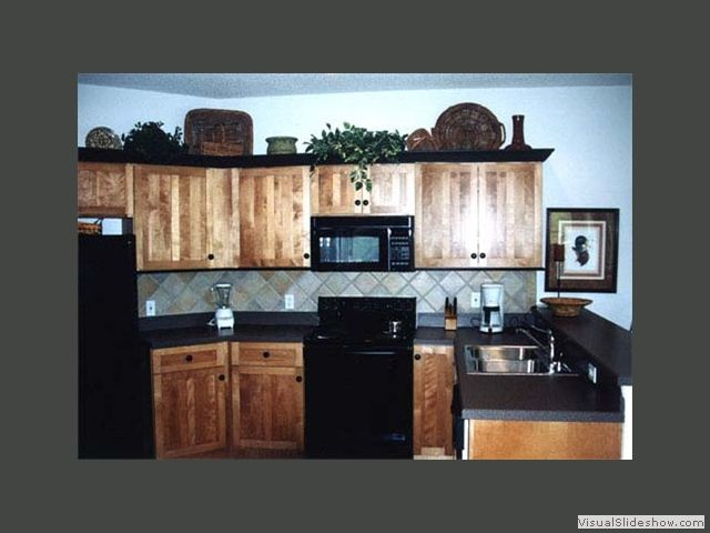 Example Of Hickory With Black Black Counter Top And Grey
