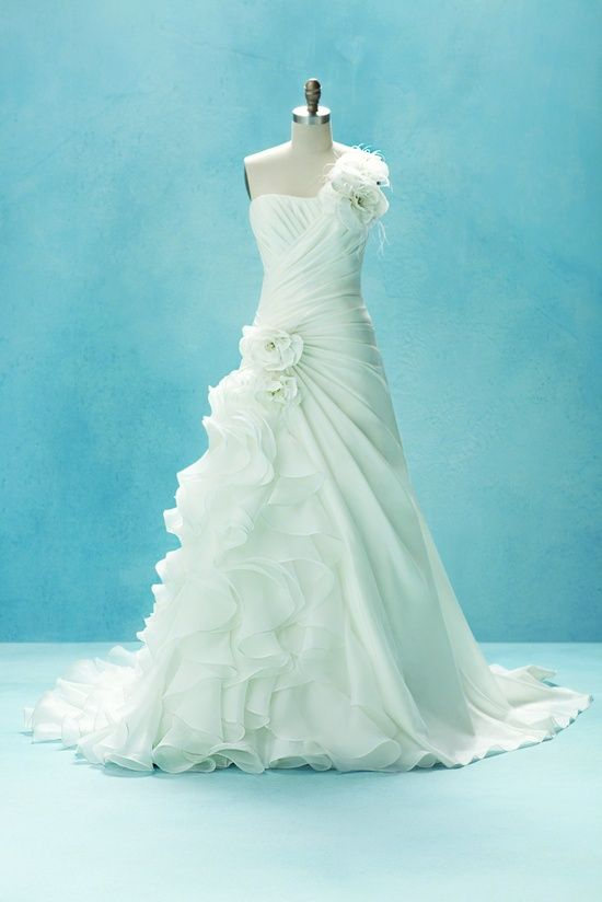 Pretty dress!!! I love the way the ruffles cascade down the side of ...