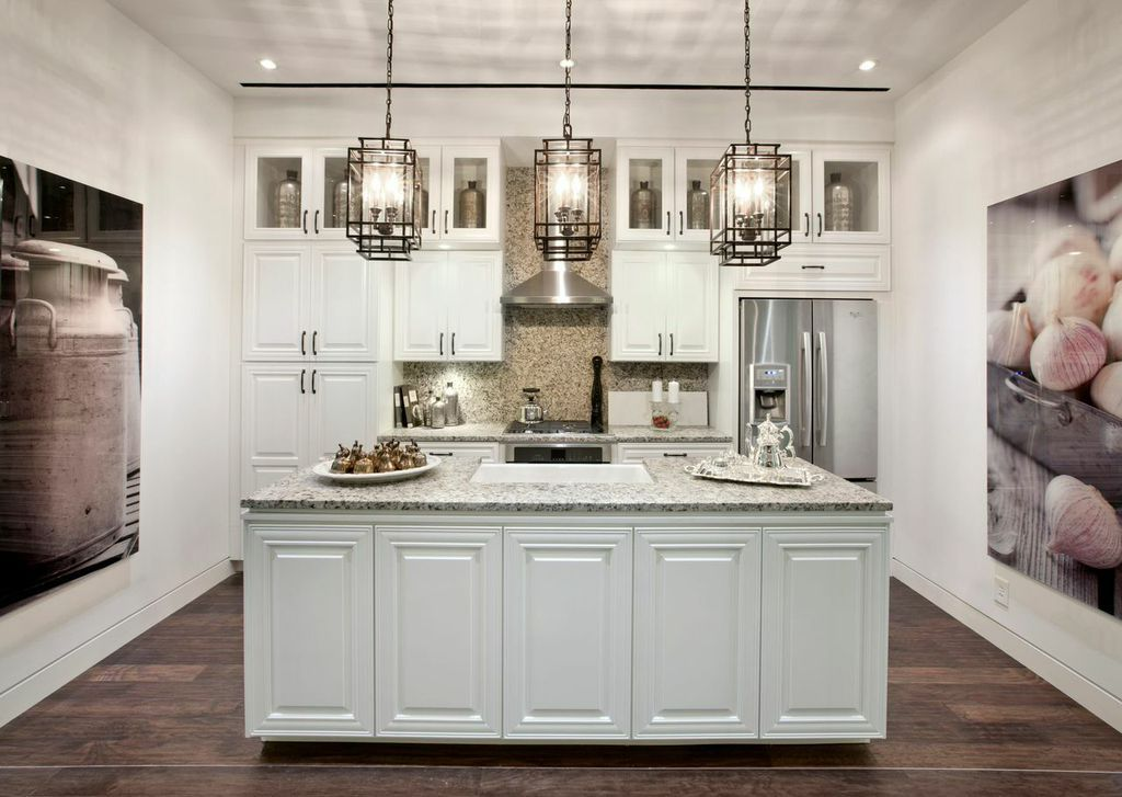 drop down lighting fixtures add an element of spaciousness to any kitchen seen in the - Drop Down Lights For Kitchen