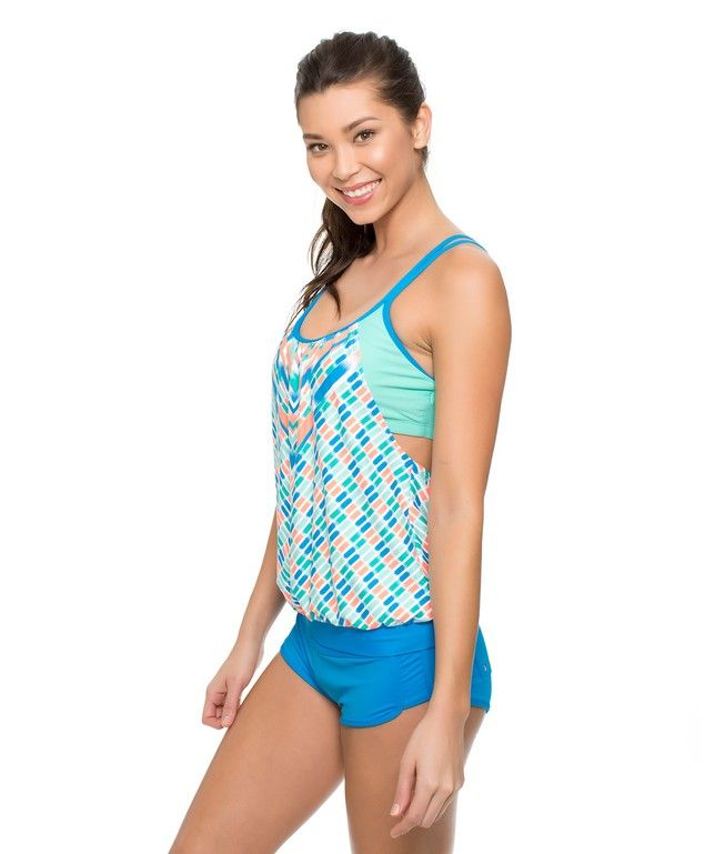 ec0282d3554d6 Go with the flow in this Next tankini. Featured in a bright blue color with  different tones of orange and green, this tankini is fit to print.