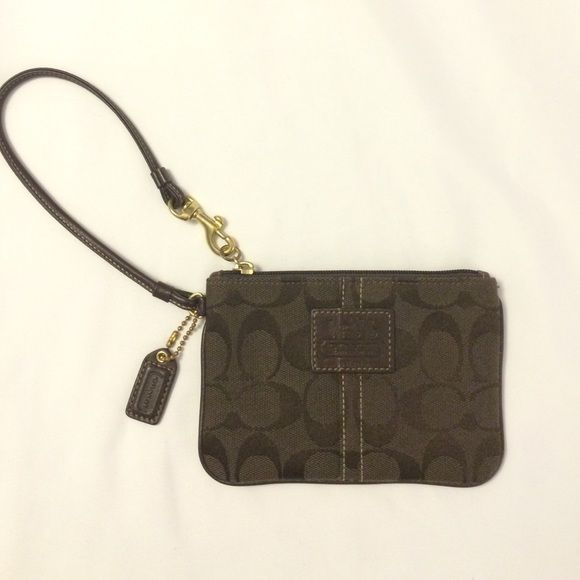 Small brown wristlet wallet from coach Little dark brown wristlet! Fits the iPhone 5 perfectly! Zips! Only used once Coach Bags Wallets