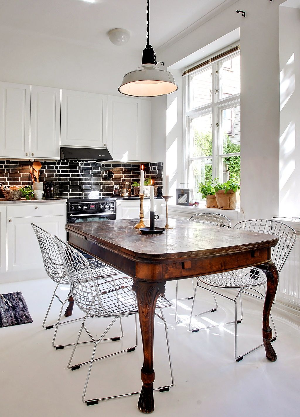 Mixing Styles Can Be Dynamic Modern Antique And Mid Century Dining Table With Bertoia Chairs