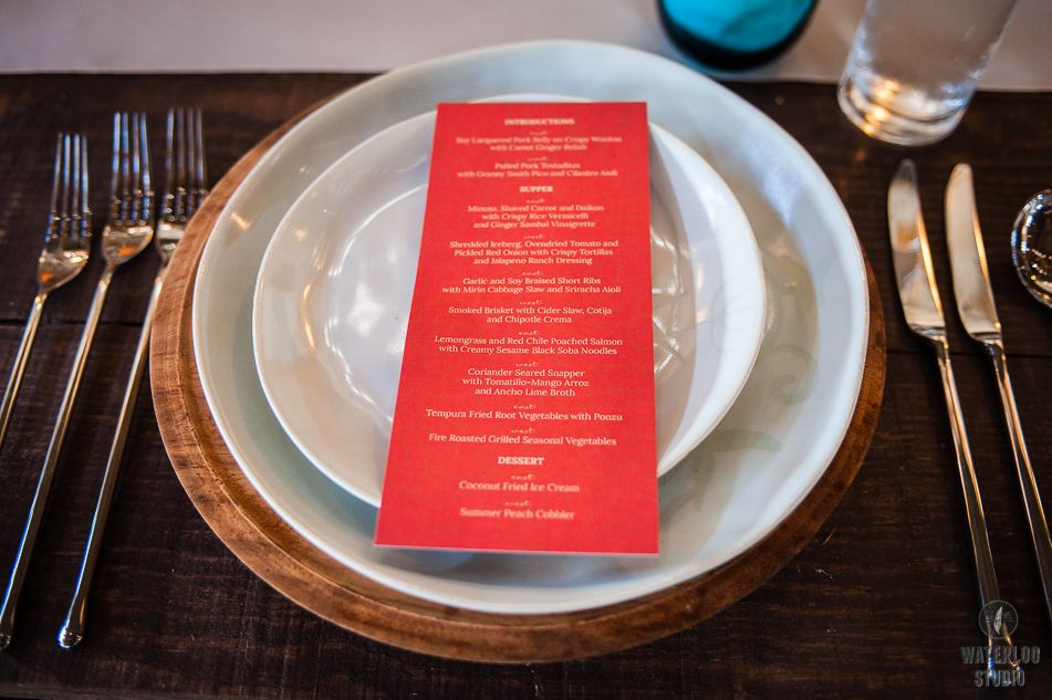 Handthrown stoneware place setting with red and blue at the East Meets West Supper Club at Camp Lucy in Dripping Springs, Texas. Photo: Waterloo Studio