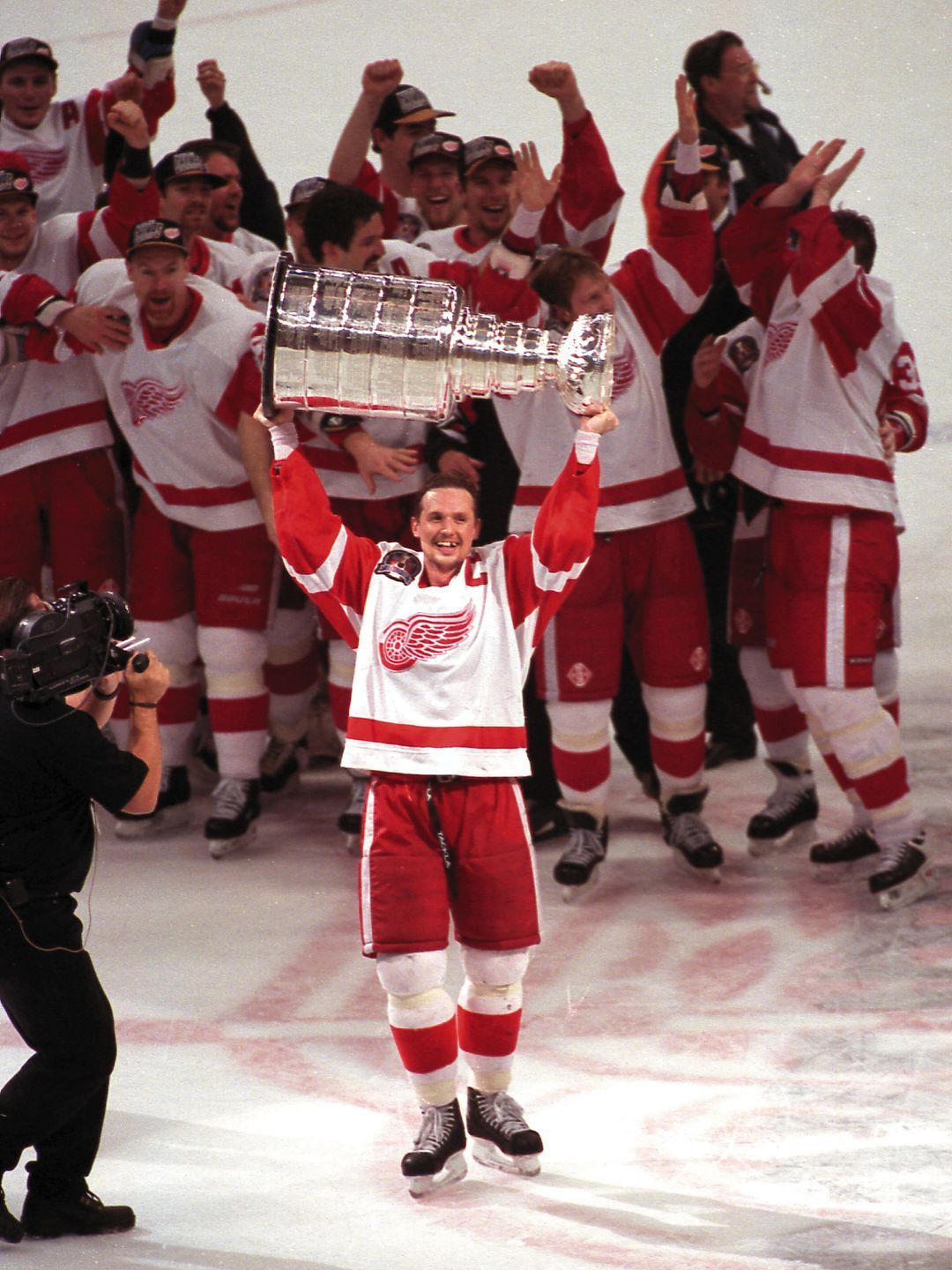 f6952dd91 Red Wings captain Steve Yzerman hoists the Stanley Cup trophy after Detroit  dispatched Philadelphia in four games to win the NHL Championship in 1997.