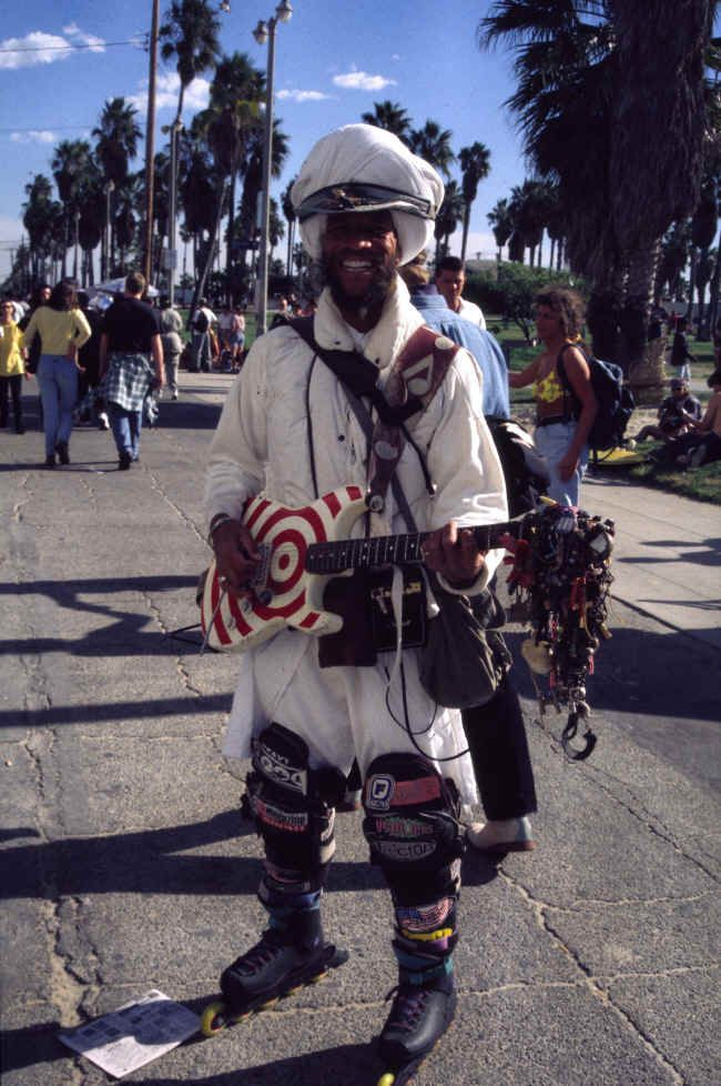 Can you believe I know someone who LIVED with this guy? For real. Venice Beach Turban-Wearing, Guitar-Playing Dude on Skates