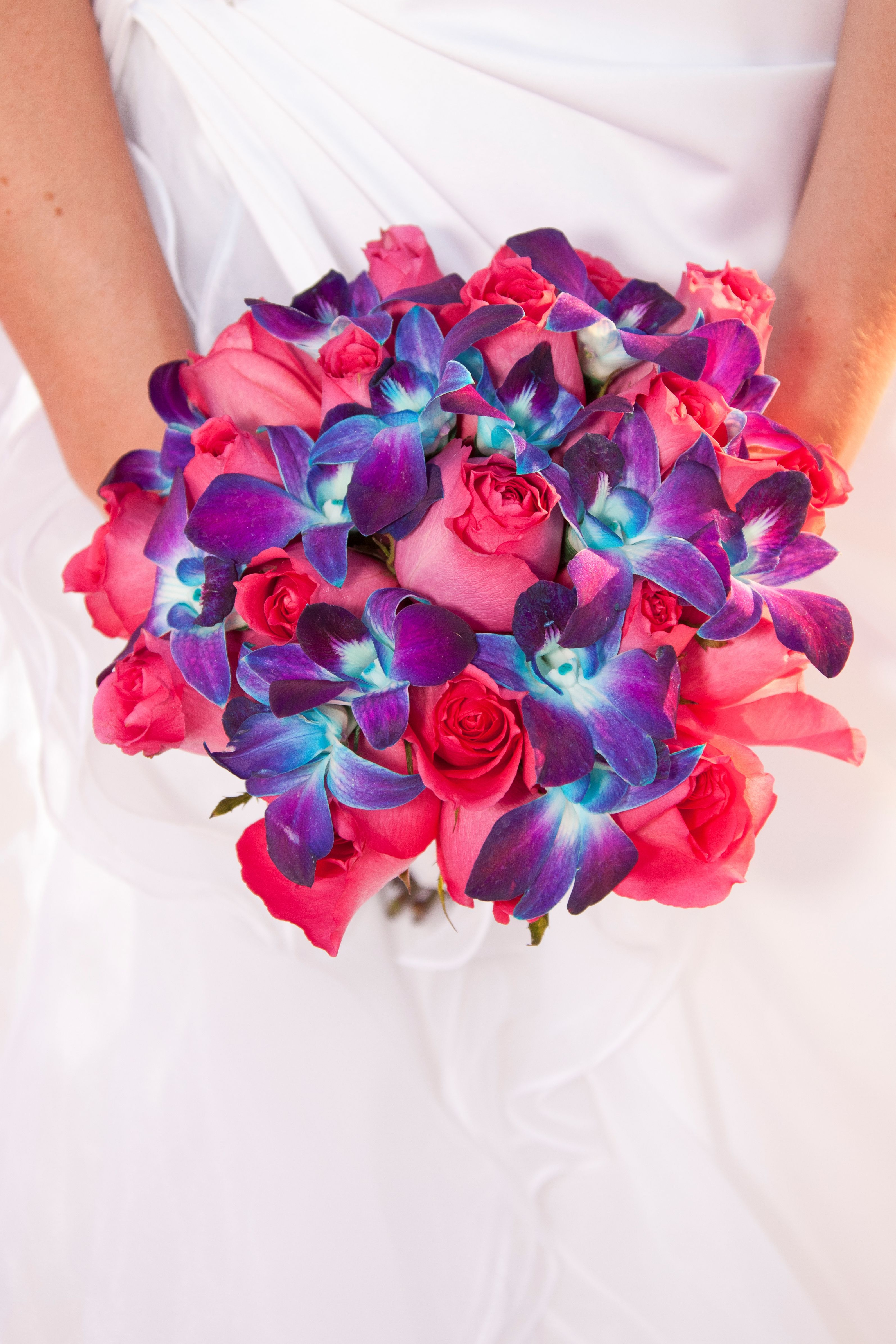Hot pink roses and blue dendrobium orchids i donut have a pin board