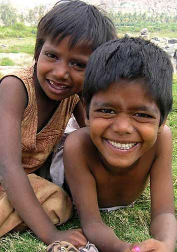 Cute little children with not to laugh about, but they are happy with what they have....