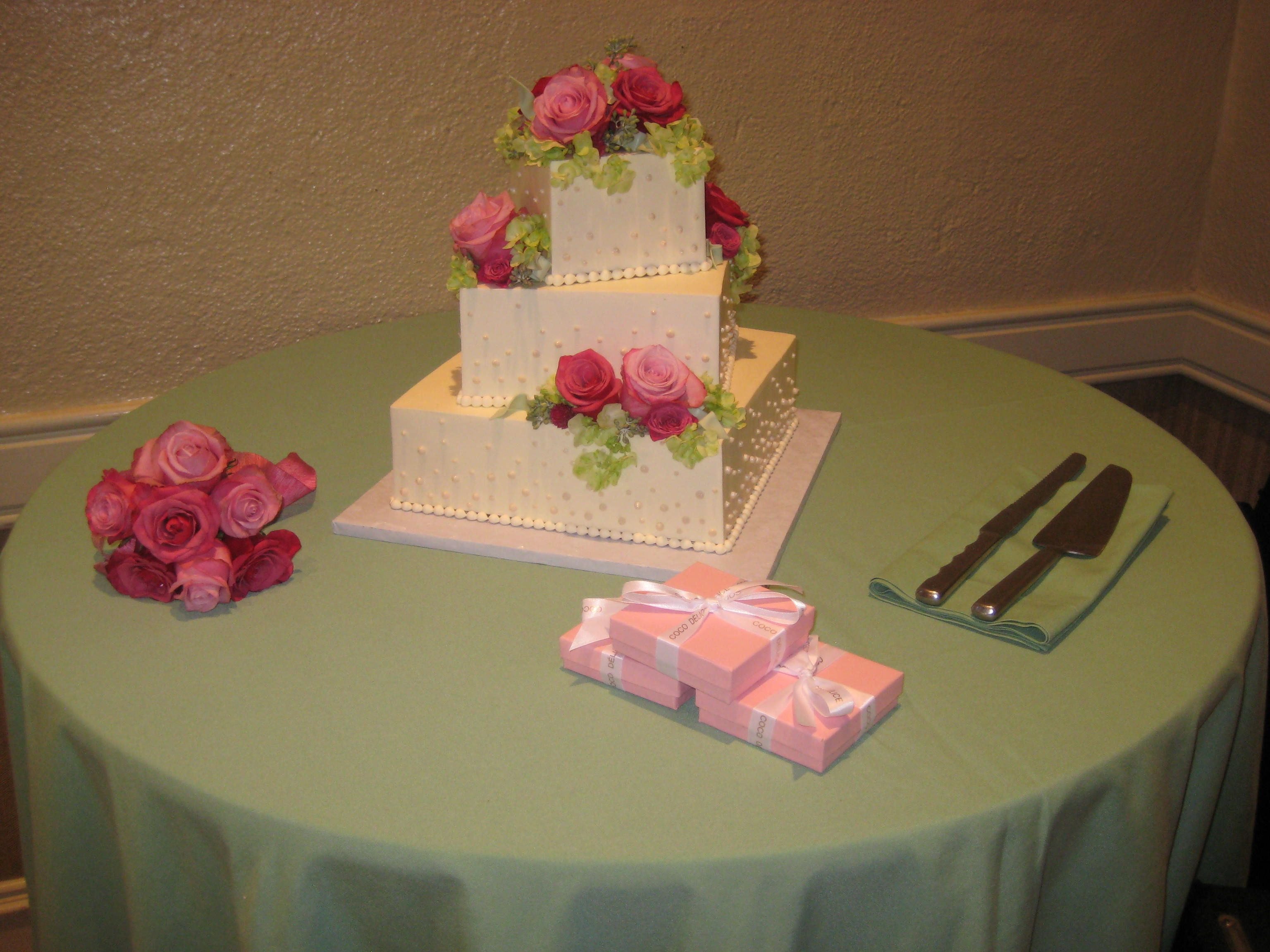 Cake table with celadon napkins and pink flowers wedding styles