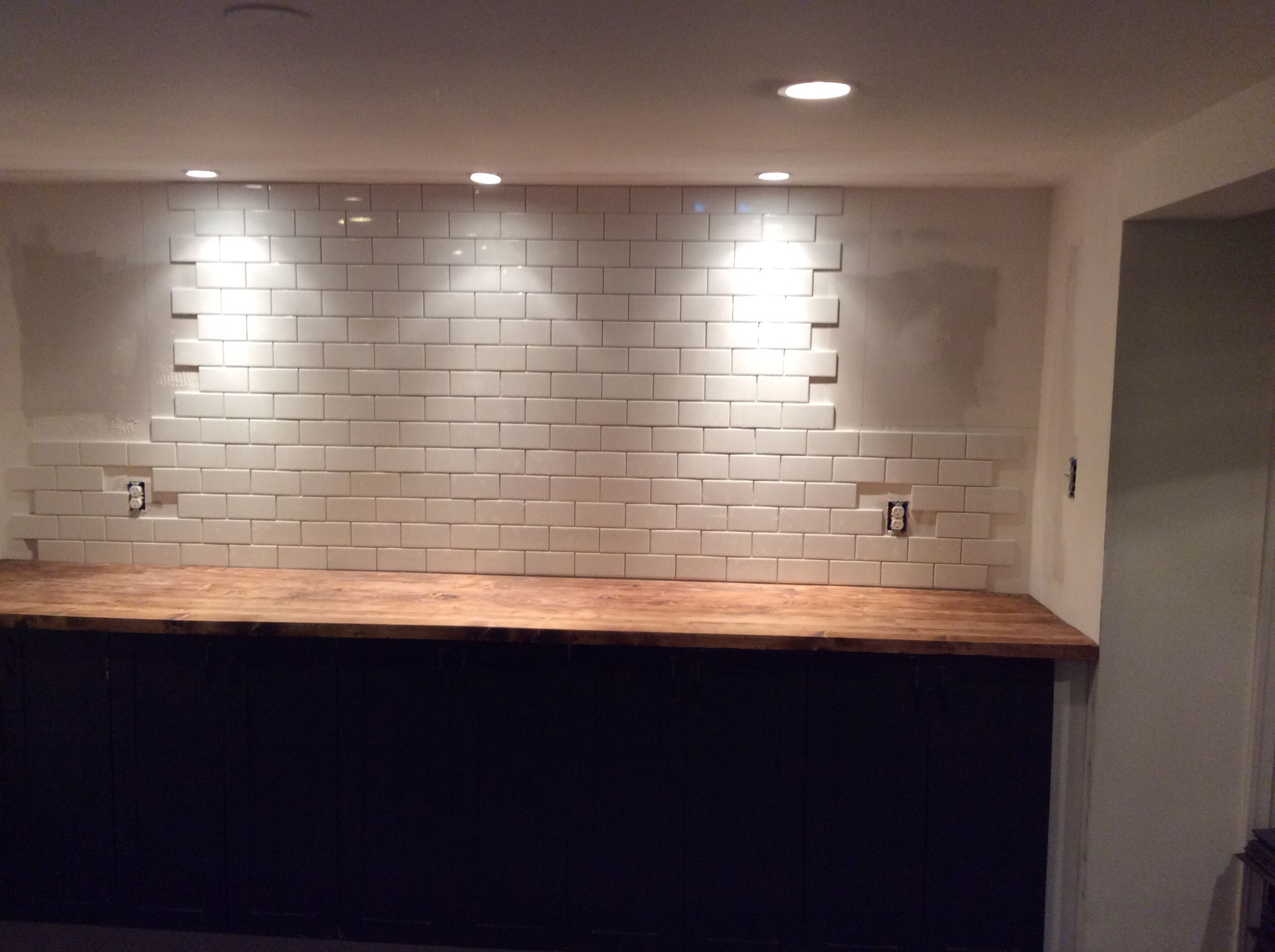 Need to add upper cabinet boxes with xs for wine storage basement