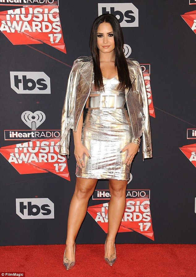 Silver fox: Demi Lovato looked sexy in this metallic creation when she stepped onto the re...