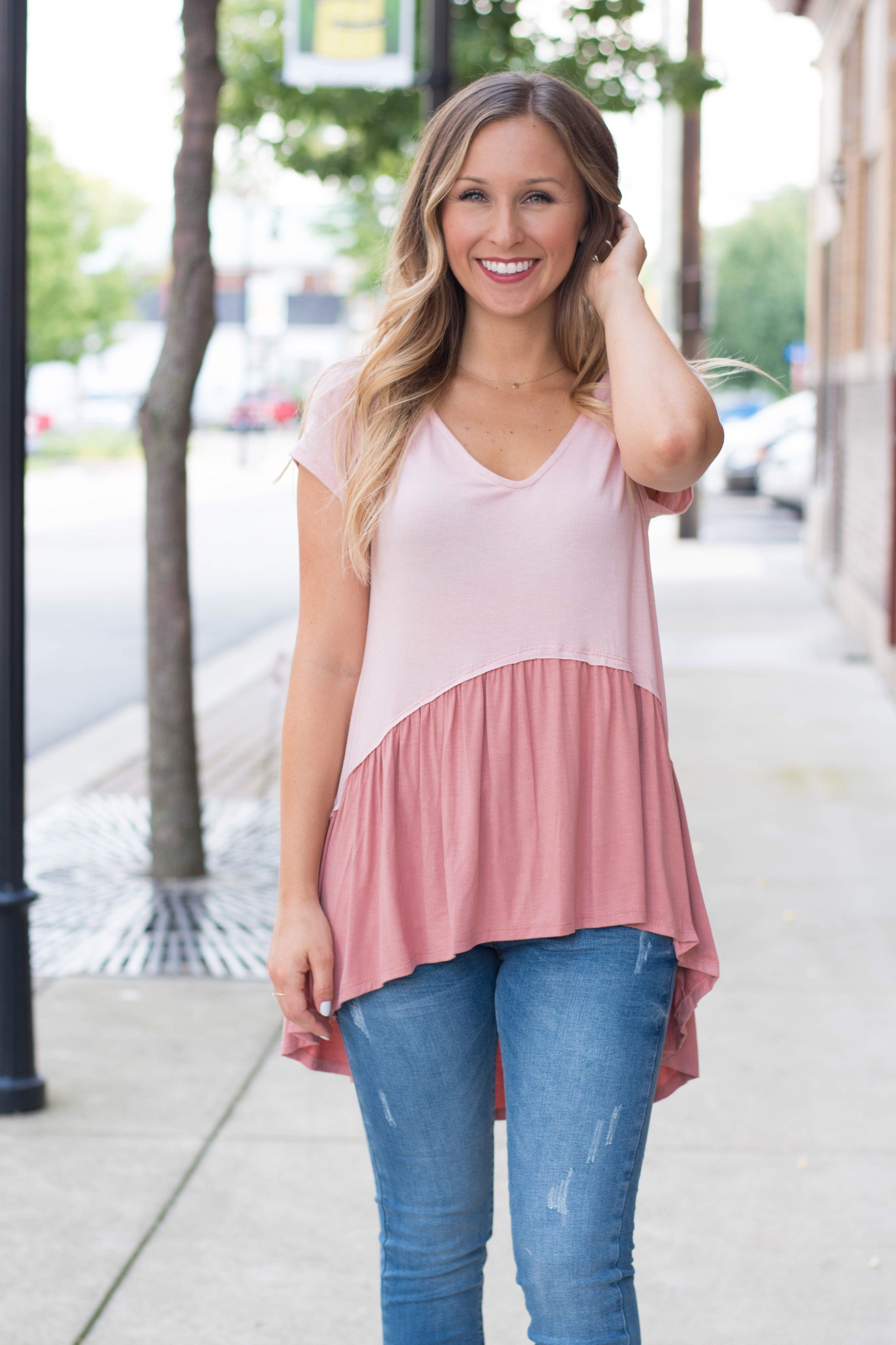 This top is your one stop look for flirty and fabulous. Hannah is ...