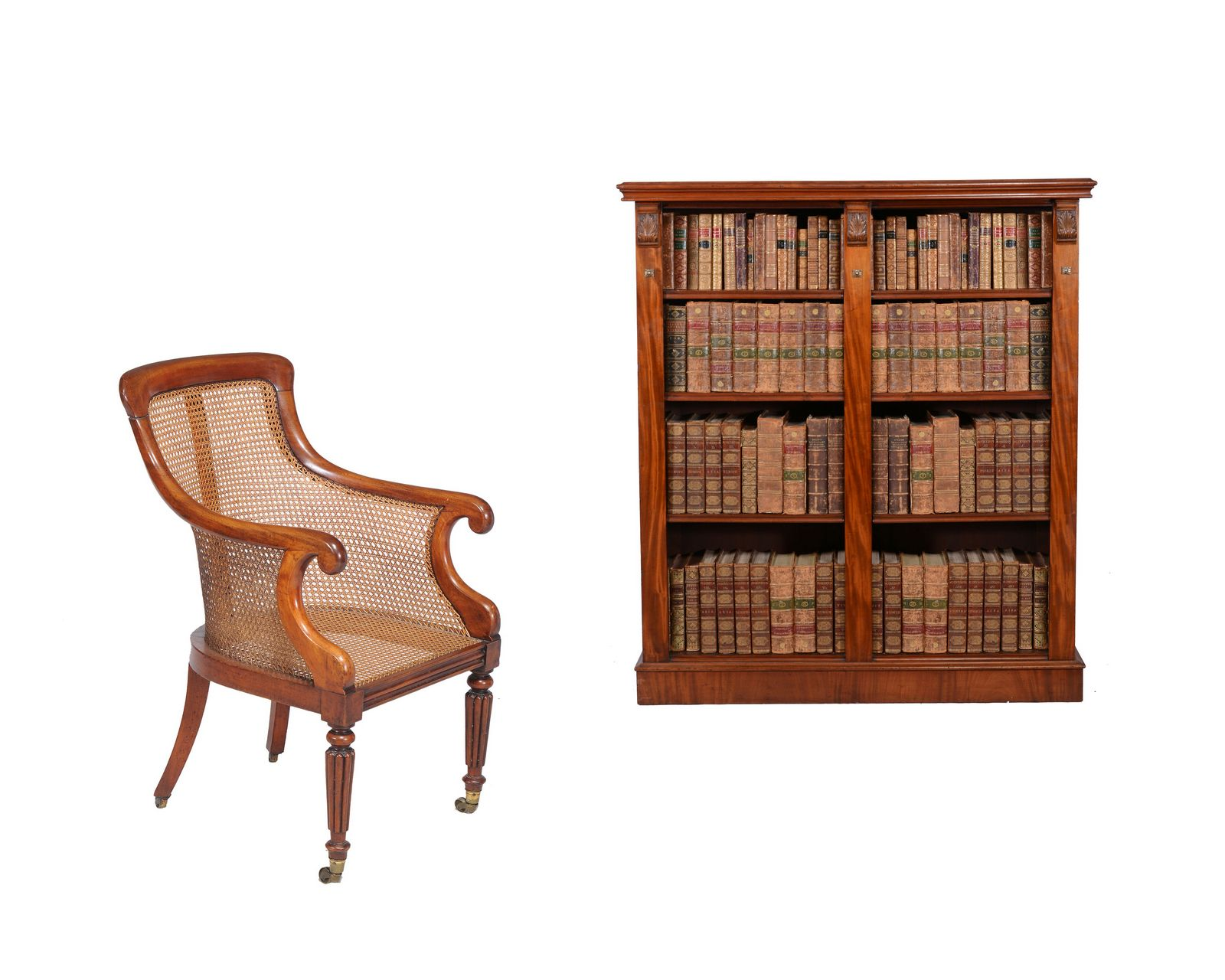 A Regency mahogany bergere armchair, circa 1815, in the manner of Gillows of Lancaster and a mahogany open bookcase, late 19th century, with two banks of adjustable shelves, with metal plaque to rear for MAPLE & CO - Dim: chair:  93cm high, 56cm wide, 57cm deep - bookcase: 154cm high, 136cm wide, 32cm deep.
