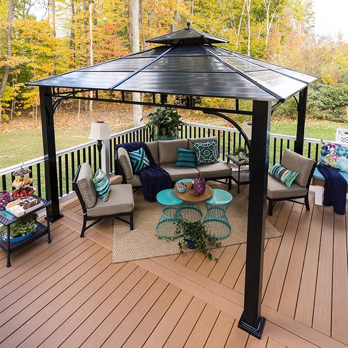A Pergola On A Composite Deck With Patio Furniture Rooftop