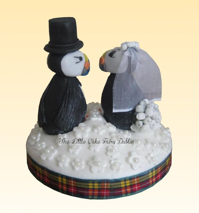 Rear View Of A Handmade Bride And Groom Puffins Wedding Cake Topper Based On The