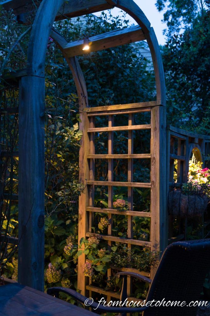 Subtle Lights Hanging from an Arbor | Landscape lighting ...