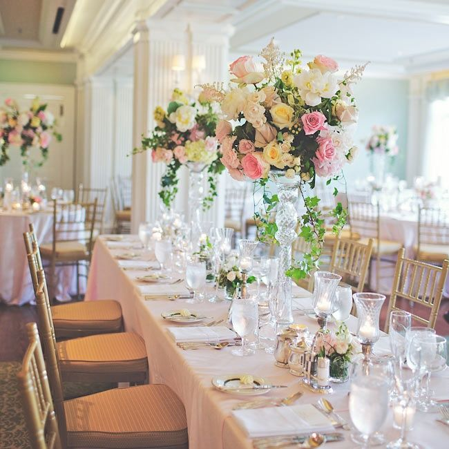 Tall bunches of roses, astilbes, hydrangeas and peonies in glass pedestals | Photographer: Hot Metal Studio | Centerpieces: Hepatica