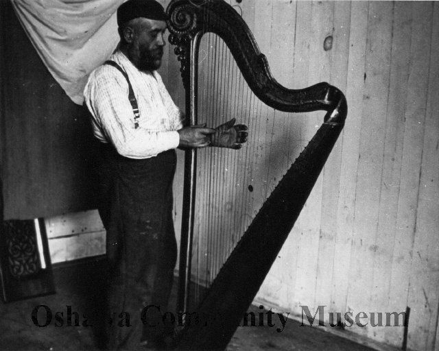 Image of A981.15.16.3, Print, Photographic: Joe Jaques Playing a Harp