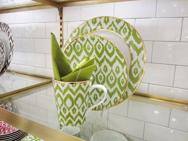 FIND: C WONDERFUL ACCESSORIES #dishware Green and white ethnic print ceramic dish ware on a floating, glass shelf with subway tile walls #dishware