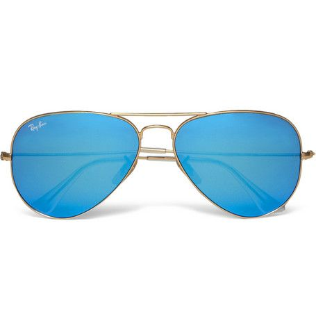 55ebd73b32 Golden metal frames in iconic Ray-Ban aviator design. Mirrored lenses with  blue effect. 100% UV protection. Padded ear pieces. Made in Italy.