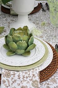 Artichokes holds votive candle glasses., Lighting up each place setting.