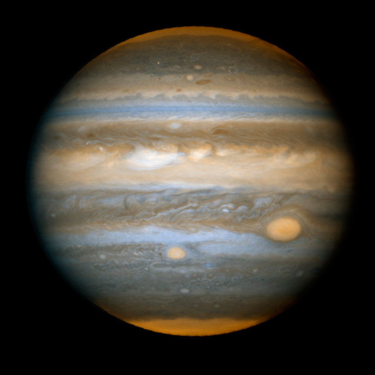 STORM OF THE CENTURY: Jupiter's Great Red Spot, located near center-right, is a spectacularly resilient storm, powered by the jet streams above and below it flowing in opposite directions.