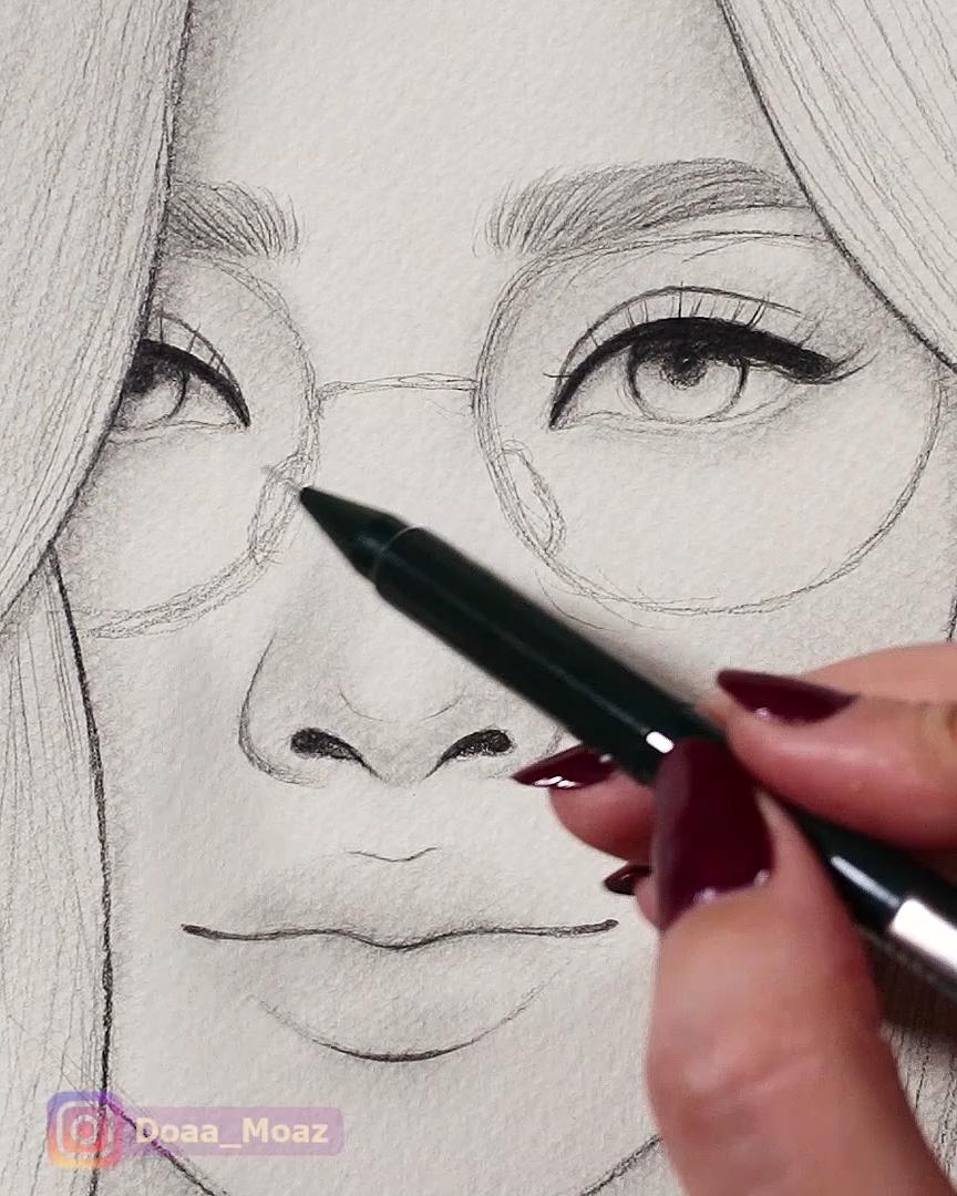Photo of Asian girl sketching