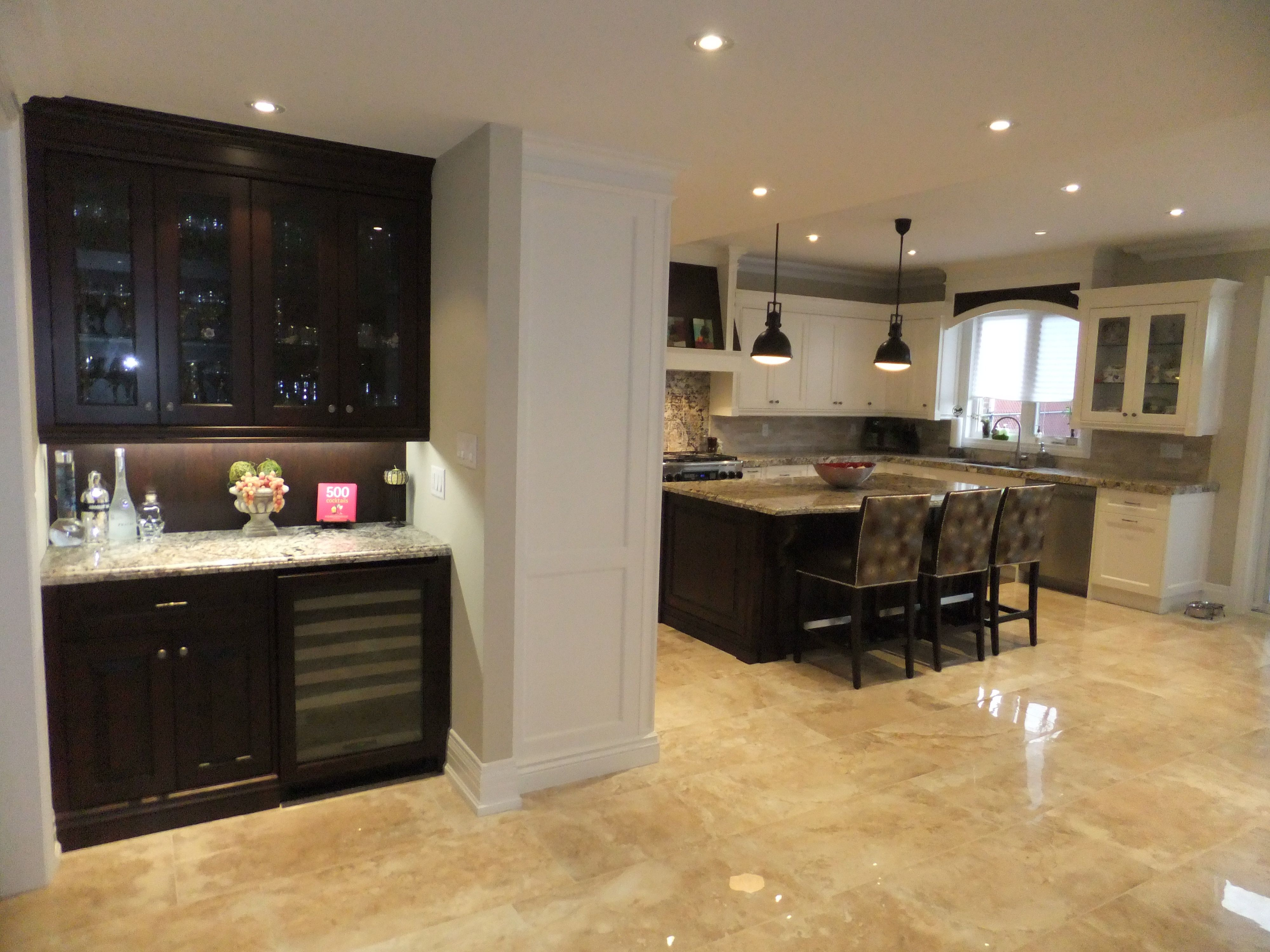 Great Open Concept Kitchen And Mini Bar With Crema Marfil Marble