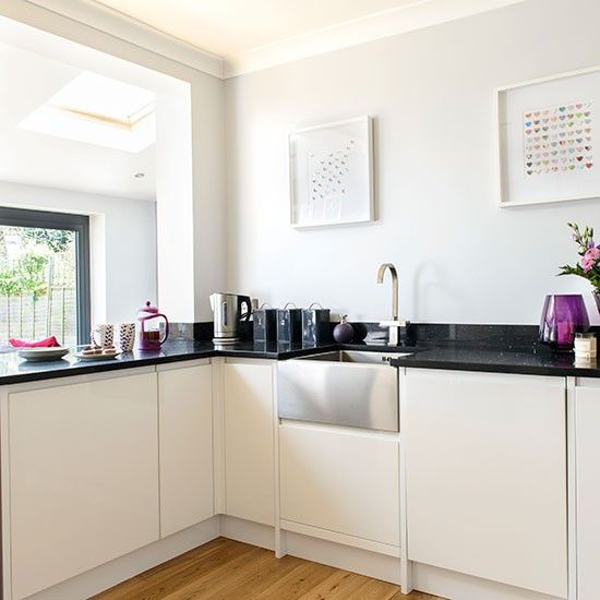 This White Kitchen Has Been Given A Contemporary Feel With Sleek Gloss Units And A Stainless