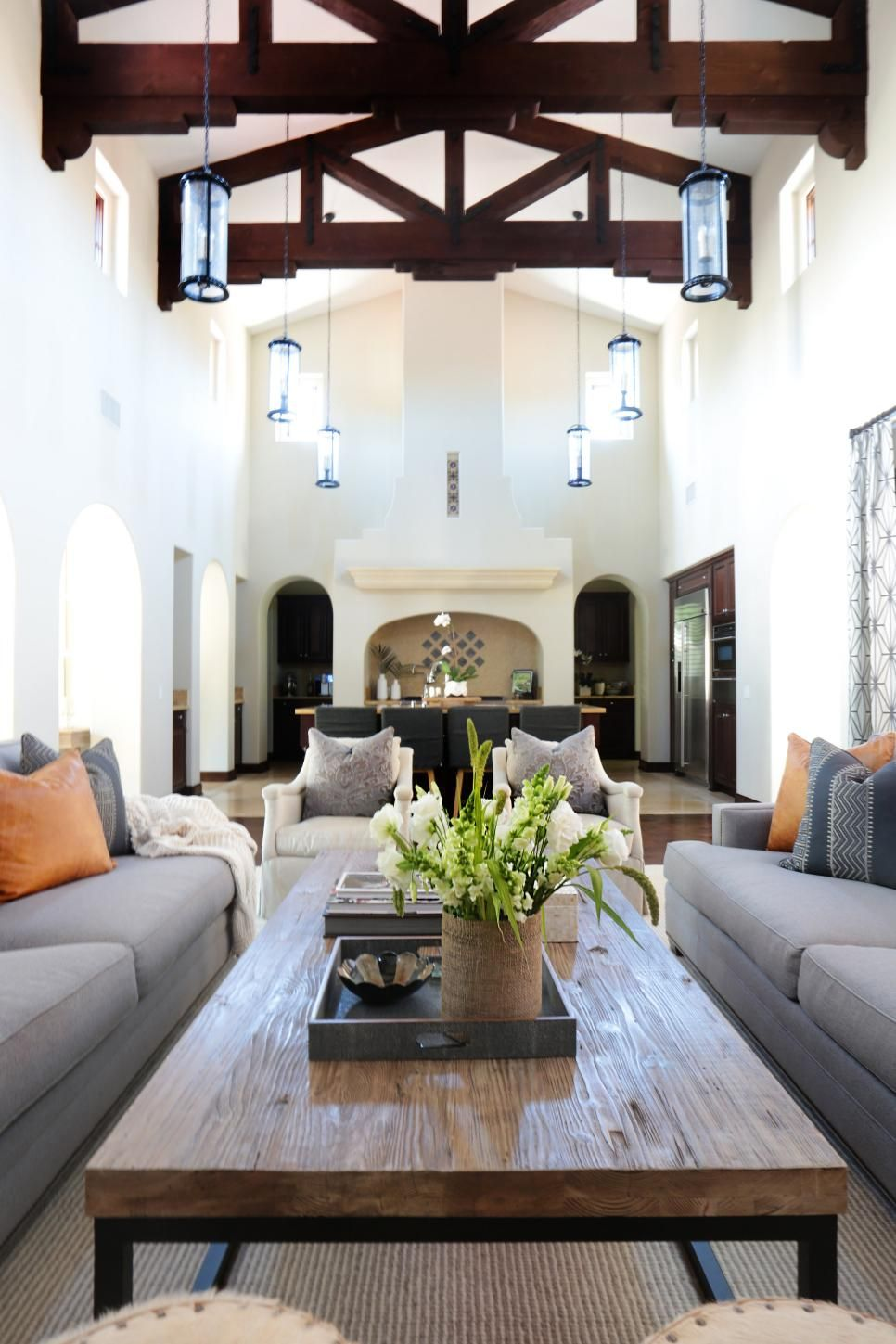 These Transitional Living And Dining Spaces Feature A Blend Of Spanish Modern And Coastal Spanish Style Home Spanish Style Homes Modern Farmhouse Living Room
