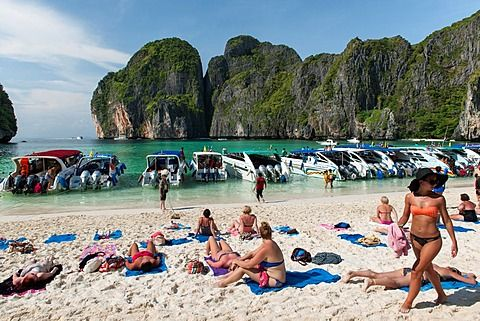 Tourist boats and tourists in Maya Bay on Koh Phi Phi Ley island in Thailand.<br />829-2200