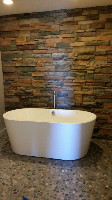 Wet room with rock wall and stone floor. Free standing tub ... on Wet Room With Freestanding Tub  id=12929